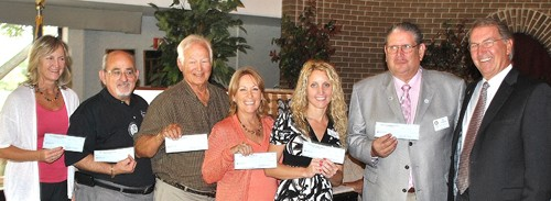 Brandon Rotary  - Picture of Charity Checks