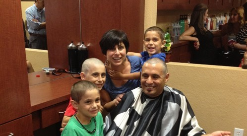 Father And Three Sons Shave Heads Together For Cut For A Cure
