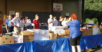 Community Comes Together To Distribute Backpacks To Area Children