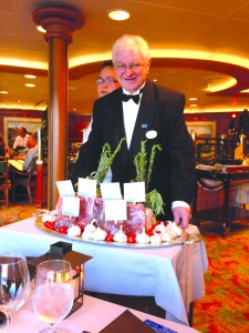 Maitre 'D Bruno Bogazzi aboard the Diamond Princess takes care of his guests.