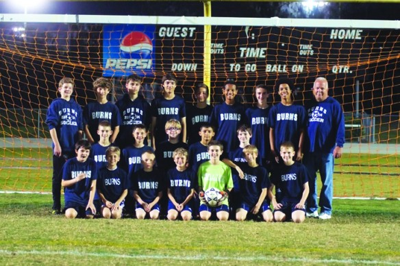 Burns Middle School Soccer Team Sports Undefeated Season, Shaves Coach's Head