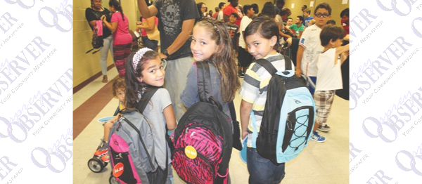 YMCA Backpack Outreach Event Sucess, School Grades Released & More