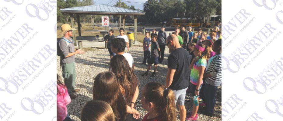 Randall Students Volunteer To Target Invasive Caesar Weed At FishHawk Preserve